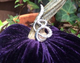 Squiggly ring with rhinestone accents in silver