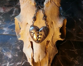 antiqued sterling silver franken-heart with stitches