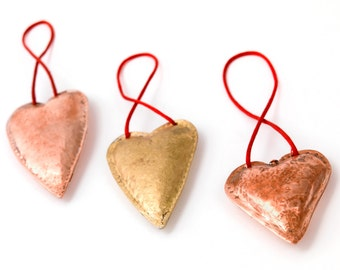 Hand made and beaten copper or brass arts and crafts style hearts, can be customised, anniversary gift?