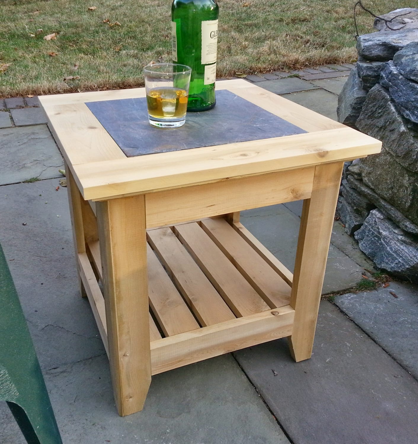 handmade cedar patio side table with a tile inlay