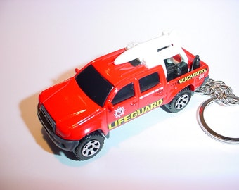 3D Toyota Tacoma custom keychain by Brian Thornton keyring key chain finished in red color lifeguard truck trim rescue 911