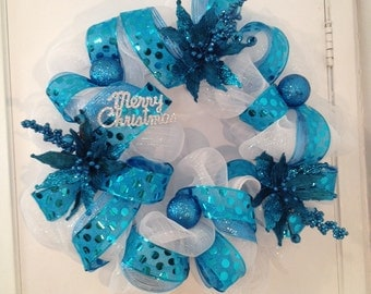 Beautiful turquoise and white deco mesh Christmas wreath.