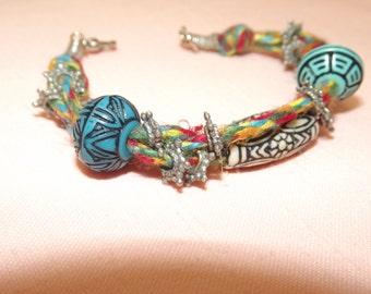 Bead and rainbow cord bracelet
