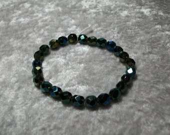 Dark Green faceted iridized jewel tone Czech glass beads.  6mm.  25 beads per strand.  1 strand available.