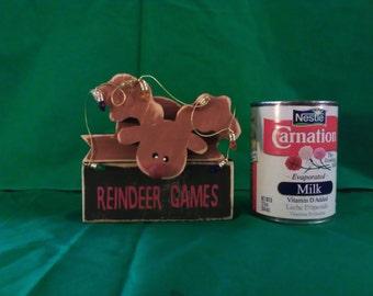 reindeer games wood figurine