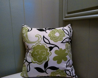 Green and Black Pillow on a Beige Background