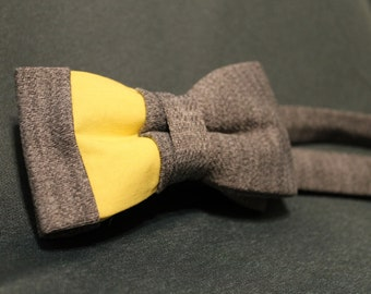 Grey and Yellow asymmetrical bow tie.