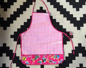 Pink oilcloth apron