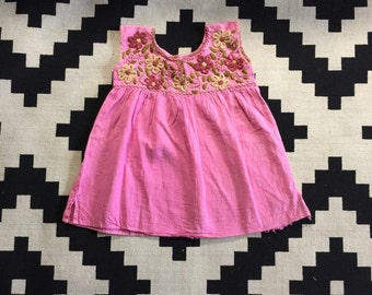Pink sundress with floral embroidery
