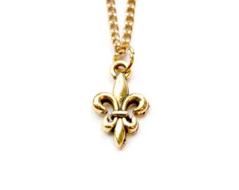 Fleur De Lis gold plated charm necklace.