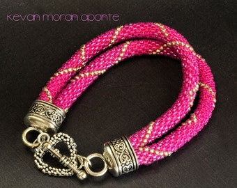 Beaded bracelet in hot pink and silver seed beads with tibetan silver clasp.