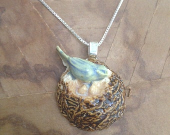 nesting blue bird pendant