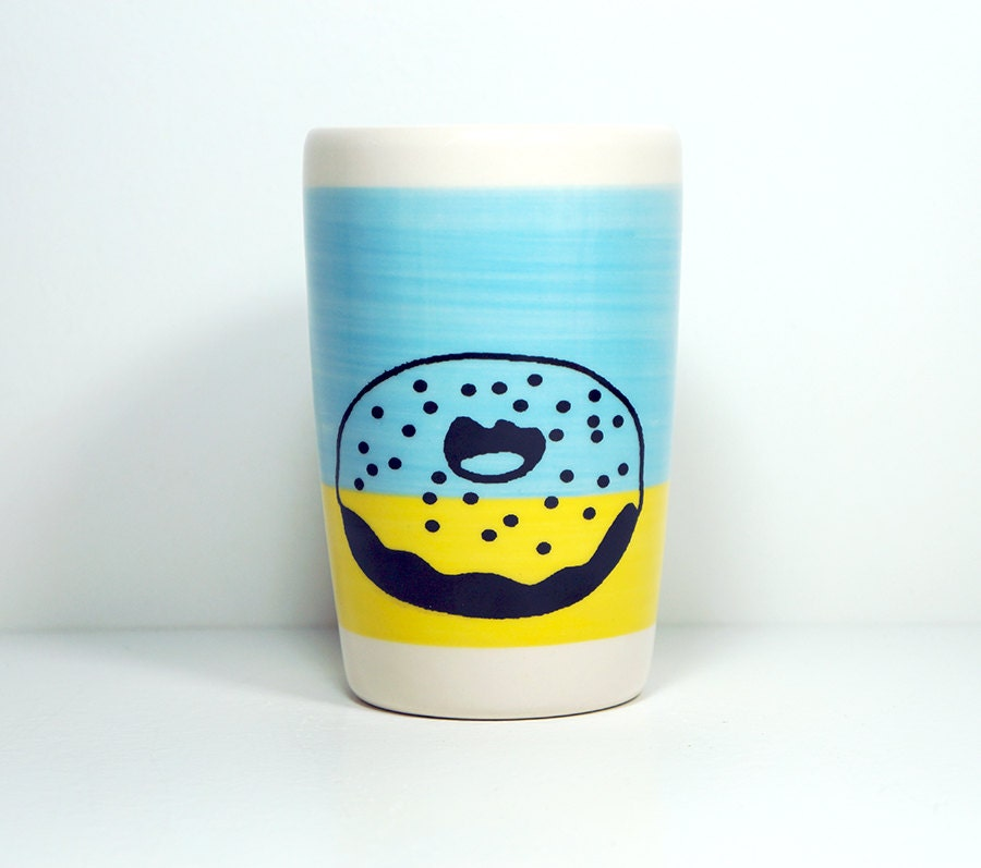 18oz tumbler with a donut on a colour block of sky blue & yellow, made to order