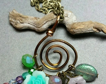Vintage Inspired Flower Charm Cluster Necklace in Golden Bronze, Mint Green, Purple, and Antiqued Brass