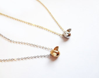 egg necklace with wings, in gold and silver