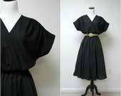DANCE AWAY . vintage black circle skirt . poly dress . fits a large to xl . made in USA