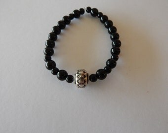 Handmade Black 8 inch Braclet , polished stones with silver accent bead