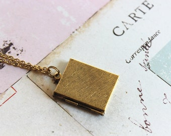 book locket necklace. gold ox jewelry