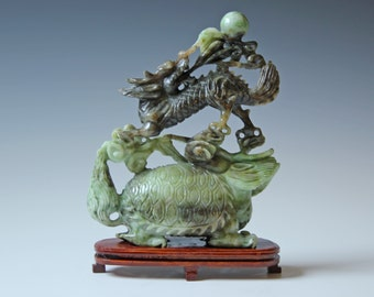 Chinese carved green hard stone dragon figure, with wood base