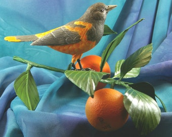 Woodcarving of a Baltimore Oriole on Orange Branch wood carving
