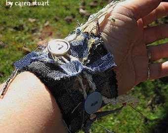 blue fabric wrist cuff bracelet coffee cup cozy with upcycled fabric and vintage buttons