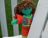 Brightly colored handmade rag doll