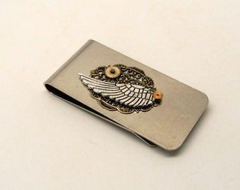 Steampunk money clip with angel wing and brass gear.