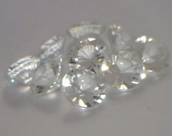 One Clear White Topaz Faceted 7mm Round Gemstone Average weight 1.32 carat