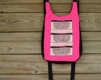Black and Neon Pink Cordura Nylon Backpack with Warning Labels