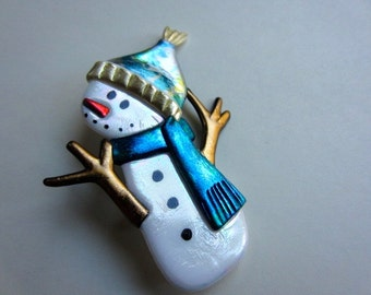 Snowman with twig arms and teal scarf pin brooch