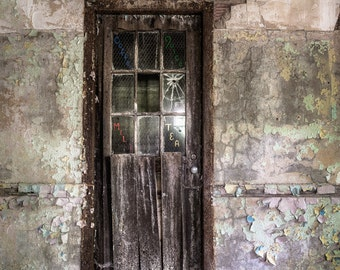 Old Door in an Abandoned Building leading to a room that served refreshments, Tea, Coffee, Milk and Juice written on the dilapidated door.