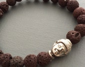 lava mala bracelet with silver buddha head bead