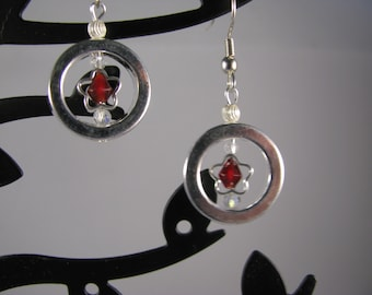 Captured Stars! Silver stars with crimson swarovksy crystals encircled with silver halo!