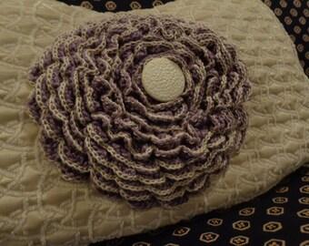 Beige textured purse with purple flower