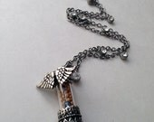 Faith Winged Capsule with Mustard Seeds and Blue Beads