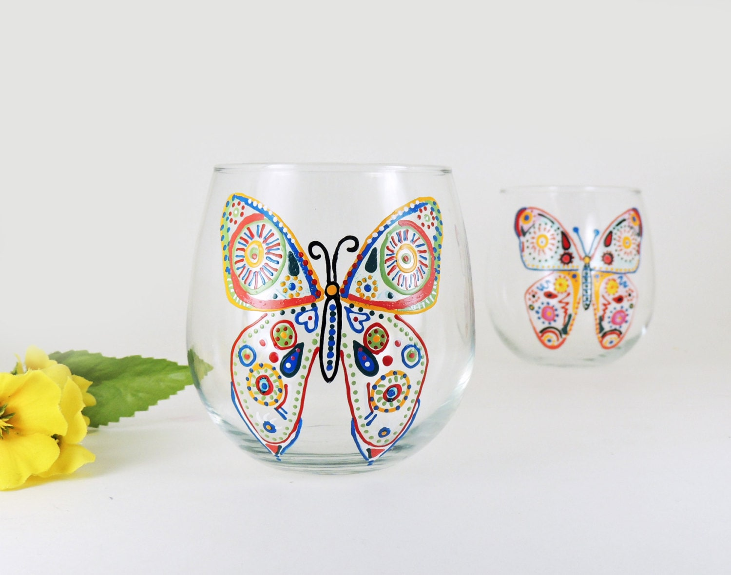 Butterfly hand painted stemless red wine by for Painted stemless wine glasses