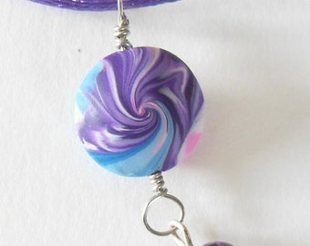 Polymer clay Necklace blue purple pink white swirled pendant with a hanging bead on a silk purple necklace