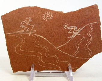 Making Tracks Ski Day Hand Carved Rock Petroglyph