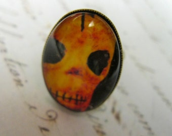 DAY OF the DEAD ring, skull image in oval setting, ox brass