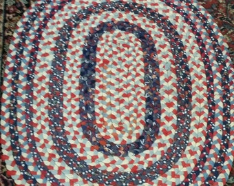 Bright And Colorful Vintage Hand Braided Rug In Shades Of Red from Rustysecrets