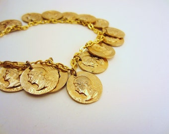 Gold charm bracelet. Upcycled charms. Raised Roman soldier, Greek soldier design. Coin bracelet. Gold jewelry. Holiday jewelry.