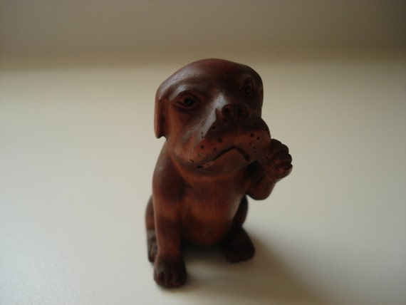 Carved boxwood netsuke bead woodland dog medicine pocket totem