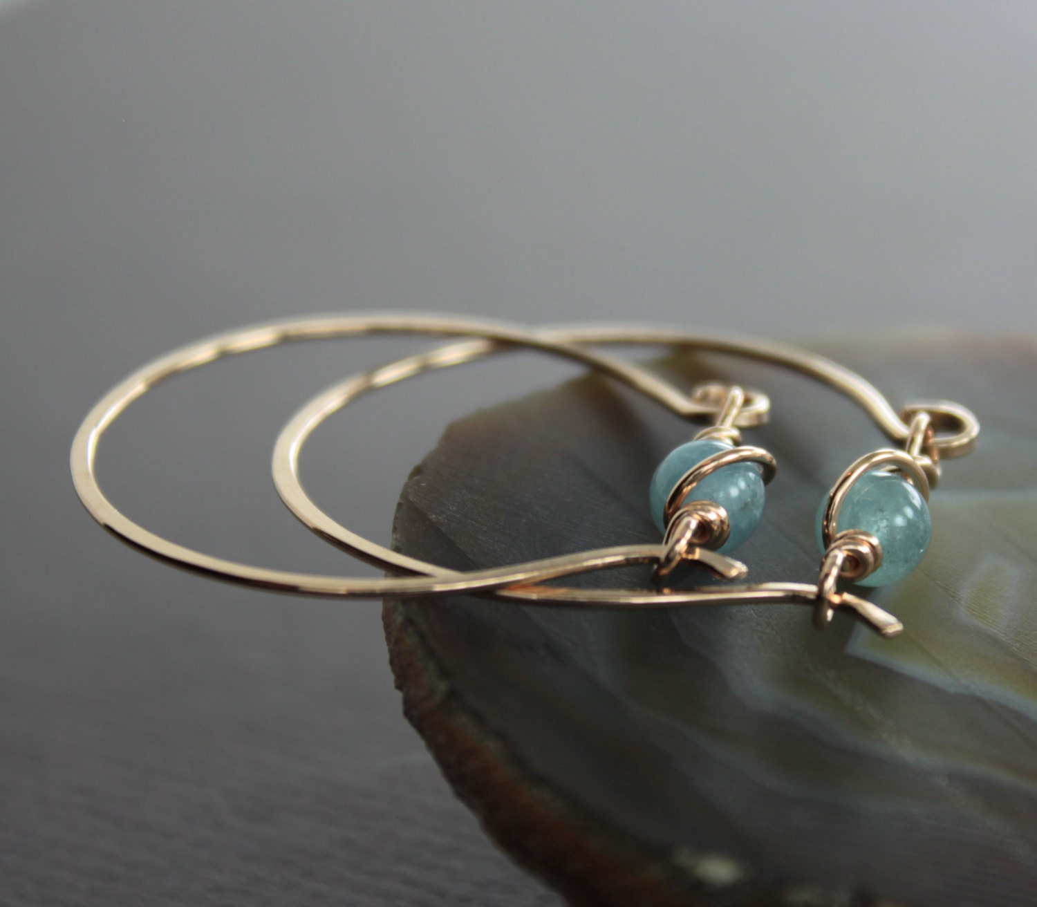 gold tone bronze hoop earrings with unique aquamarine