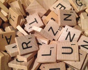 100 wood Scrabble tiles.  Random letters