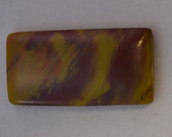 19mm x 37mm rectangular Arizona rainbow petrified wood cabochon
