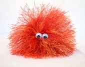 Stuffed toy orange red crochet puff ball wiggle eyes soft plush faux fur round fluffy squishy creature named Flame not for children