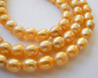 Freshwater Large Hole Rice Pearls Orange 9mm Half Strand 10 Pieces