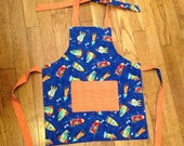 items similar to toddler baby apron blue space space ship moon stars orange apron for. Black Bedroom Furniture Sets. Home Design Ideas