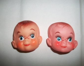 A Pair of Vintage Soft Plastic Doll Freckle Faces