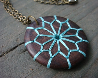 Embroidered Wood Necklace with Geometric Floral Design